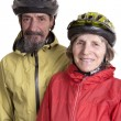 Happy retired couple wearing active sportwer and bicycle helmet — Stock Photo