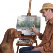 Painting lesson for a dog — Stockfoto