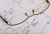 Glasses on plans — Stock Photo