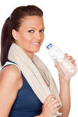 Gymnastics girl with a towel and water — Stock Photo