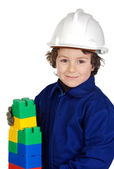 Future builder constructing a brick wall with toy pieces — Stock Photo