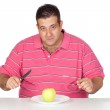 Fat man eating a apple — Stock Photo #9424619