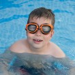 Child in the pool - Foto Stock
