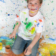 Stockfoto: Little boy playing with painting
