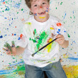 图库照片: Funny little boy painted his hand