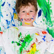 Stock Photo: Boy playing with painting
