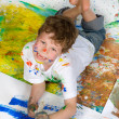 Boy playing with painting — 图库照片