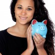 Attractive girl with a blue piggy-bank — Stock Photo #9425770