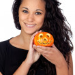 Attractive girl with Halloween flashlight — Stock Photo