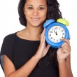 Attractive girl with a alarm clock - Stock Photo