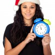 Attractive woman with Christmas hat and a clock — Stok fotoğraf