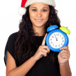 Stock Photo: Attractive womwith Christmas hat and clock
