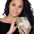 Brunette woman with a gift - Stock Photo