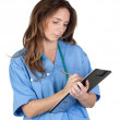 Doctor woman doing report — Stock Photo