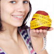 Attractive girl with apple and tape measure in the hand — Stock Photo