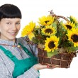 Attractive happy woman dressed gardener - Stock Photo