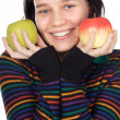 A pretty woman holding  apples - Stock Photo
