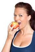 体操の女の子の食用リンゴ — ストック写真