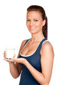 Attractive girl with glass of milk — Stock Photo