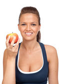 Gymnastics girl with an apple — Stock Photo
