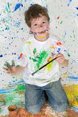Funny little boy painted his hand — Stock Photo