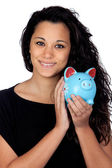 Attractive girl with a blue piggy-bank — Stok fotoğraf