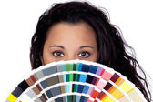 Attractive woman with a large sample of color — Stock Photo