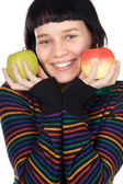 A pretty woman holding apples — Stock Photo