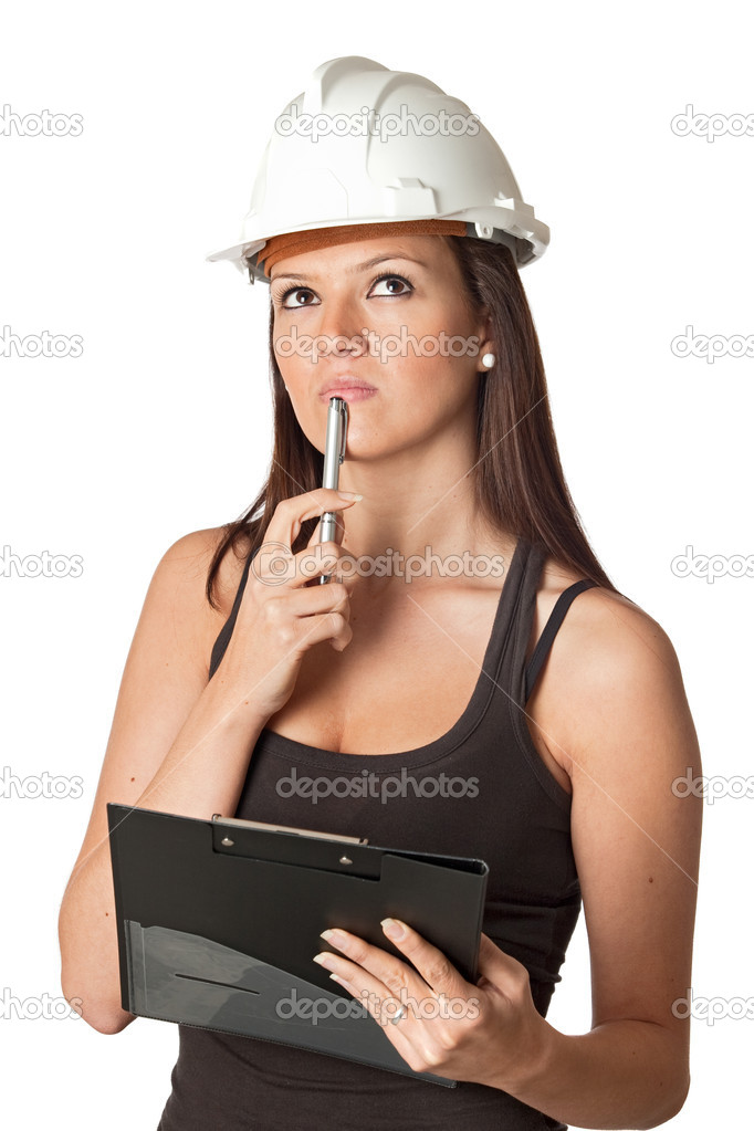 Pensive young engineer isolated on a over a white background — Stock Photo #9424884