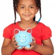 Stock Photo: African little girl with a blue piggy-bank