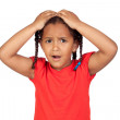 Surprised little girl with hands on head — Stock Photo