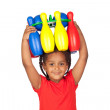 African little girl with with a bowling game on his head — Stock Photo #9430712