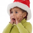 Surprised baby girl with red hat of Christmas — Stock Photo