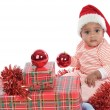 Baby girl with christmas presents — Stock Photo #9430967
