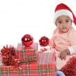 Baby girl with christmas presents — Foto de Stock