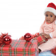 Baby girl with christmas presents — Stock Photo