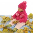 Baby playing with leaves — Stock Photo #9430988