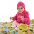 Baby playing with leaves — Stock Photo #9430996