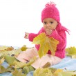 Baby playing with leaves — Stock Photo #9431003