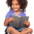 Student little girl reading with a book — Stock Photo #9431021