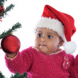Baby girl playing with christmas tree — Stock Photo #9431043