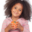 Adorable african little girl with beautiful hairstyle with a pum — Stock Photo #9431223