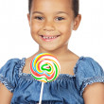 Girl with lollipop — Stock Photo #9431224