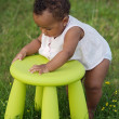 Toddler playing with chair — Stock Photo #9431265