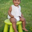 Toddler playing with chair — Stockfoto