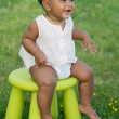 Toddler playing with chair — Stock Photo