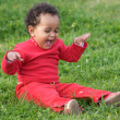 Baby playing on the grass — Stock Photo #9431326
