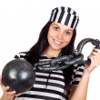 Beautiful prisoner with inmate ball  — Stock Photo