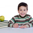Adorable child writing in the school — Stock Photo #9431831