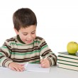 Adorable child writing in the school — Stock Photo #9431836